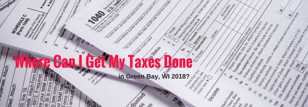 Where Can I Get My Taxes Done in Green Bay, WI 2018, text on an image of a stack of tax papers