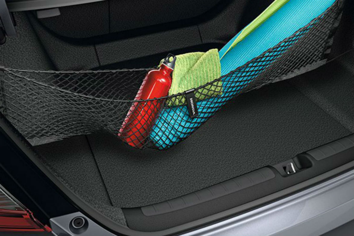 Available trunk cargo net holding yoga gear in the trunk of the 2018 Honda Accord Sedan