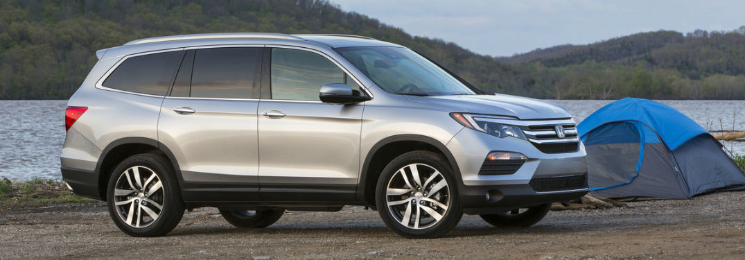 Passenger side exterior view of a gray 2018 Honda Pilot