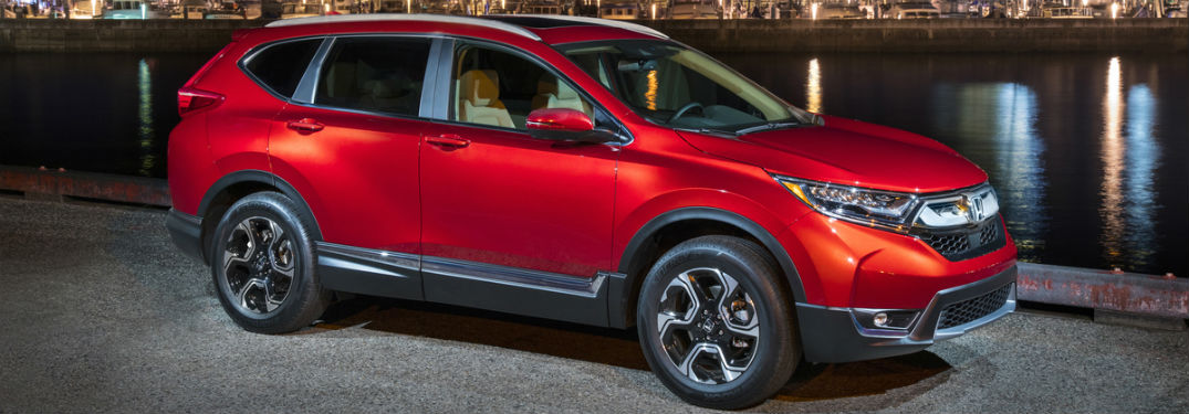 Passenger side exterior view of a red 2018 Honda CR-V