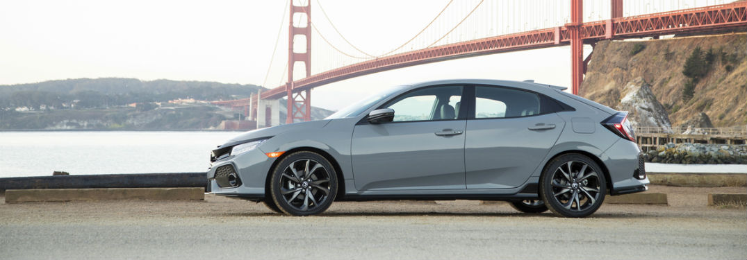 Driver side exterior view of a gray 2018 Honda Civic Hatchback