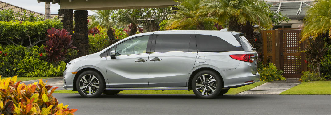 Driver side exterior view of a gray 2019 Honda Odyssey