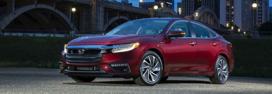 Driver side exterior view of a red 2019 Honda Insight