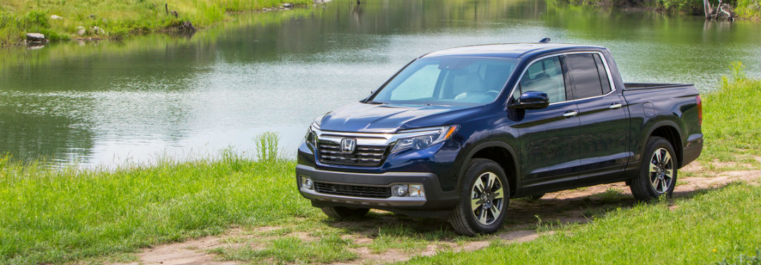 Front driver side exterior view of a blue 2019 Honda Ridgeline