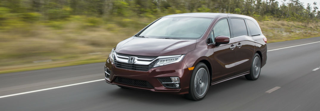 Front driver side exterior view of a red 2019 Honda Odyssey