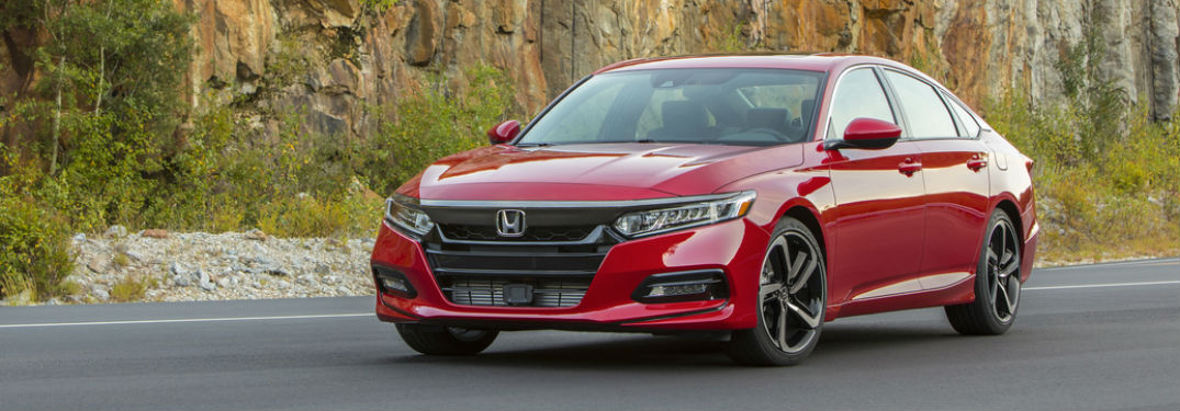 Front driver side exterior view of a red 2019 Honda Accord