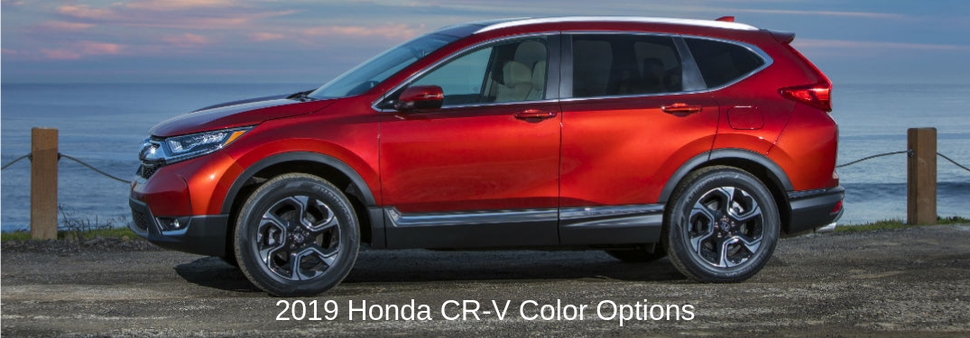 2019 Honda CR-V Color Options, ext on a driver side exterior image of a red 2019 Honda CR-V