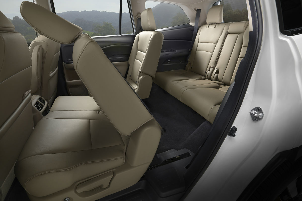 Second-row bench seat of the 2019 Honda Pilot folded forward to give easy access to the third-row seat