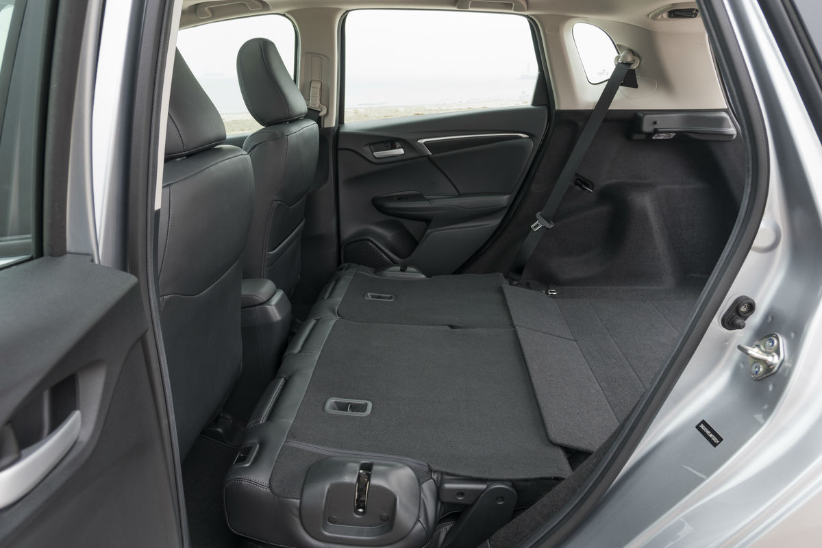 Side view of the rear seats folded flat for storage in the 2019 Honda Fit