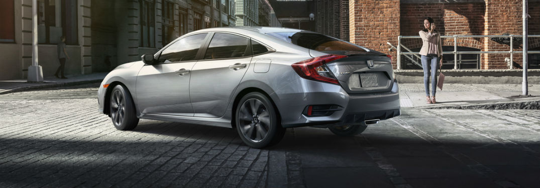 Rear driver side exterior view of a gray 2019 Honda Civic Sedan