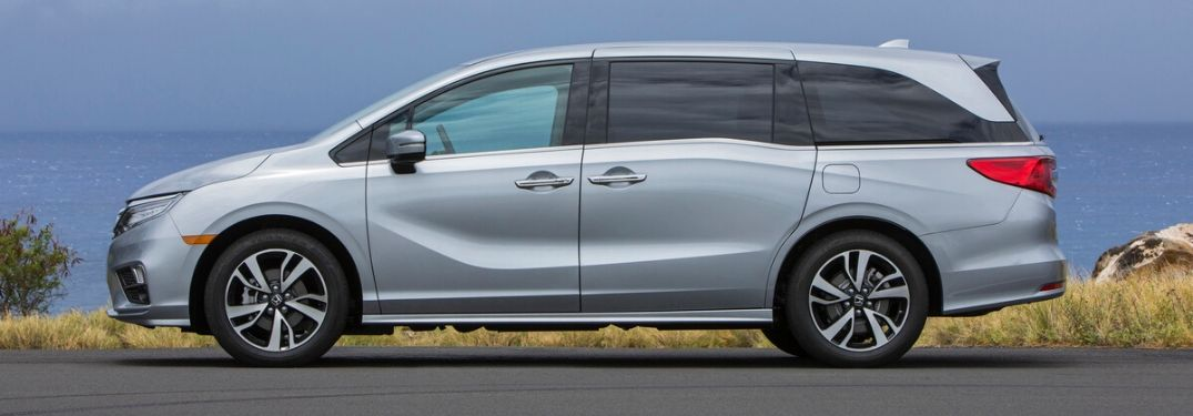 2020 Honda Odyssey in front of water from exterior driver side