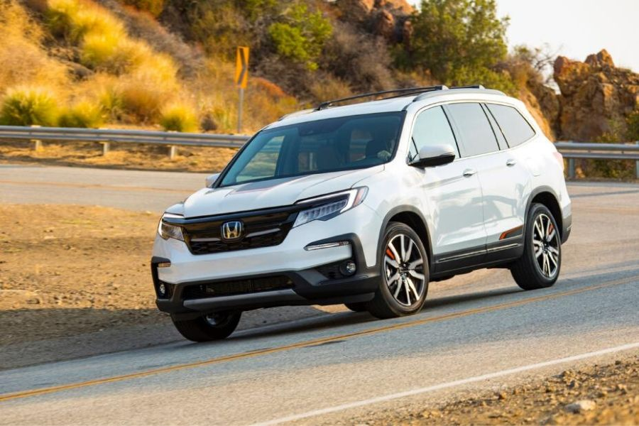 2020 Honda Pilot Elite driving down the road from exterior front drivers side angle
