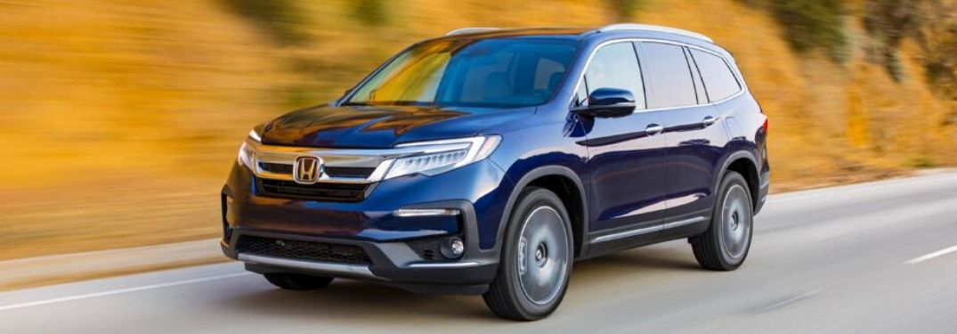 2020 Honda Pilot driving on road from exterior front driver side view