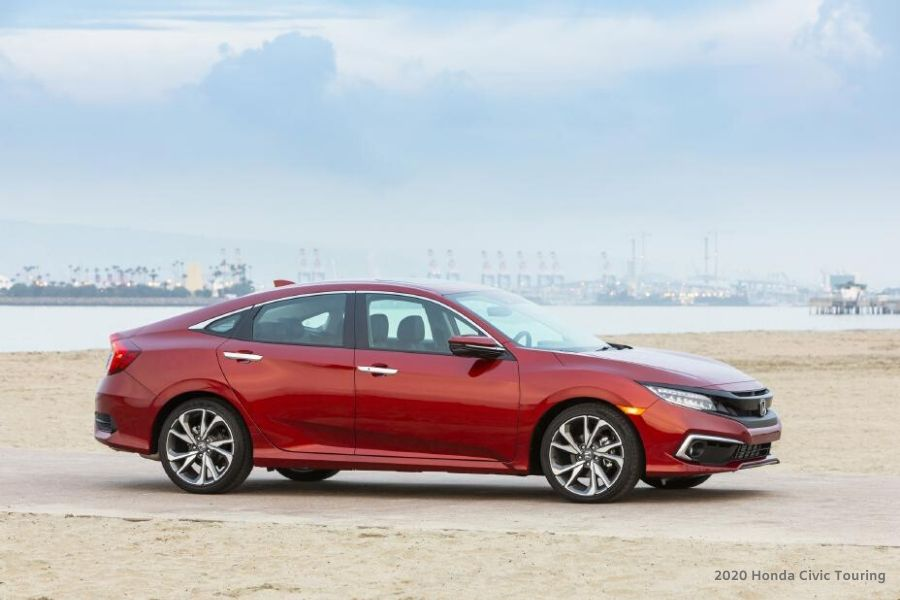 Red 2020 Honda Civic Touring from exterior passenger side angle with water in background