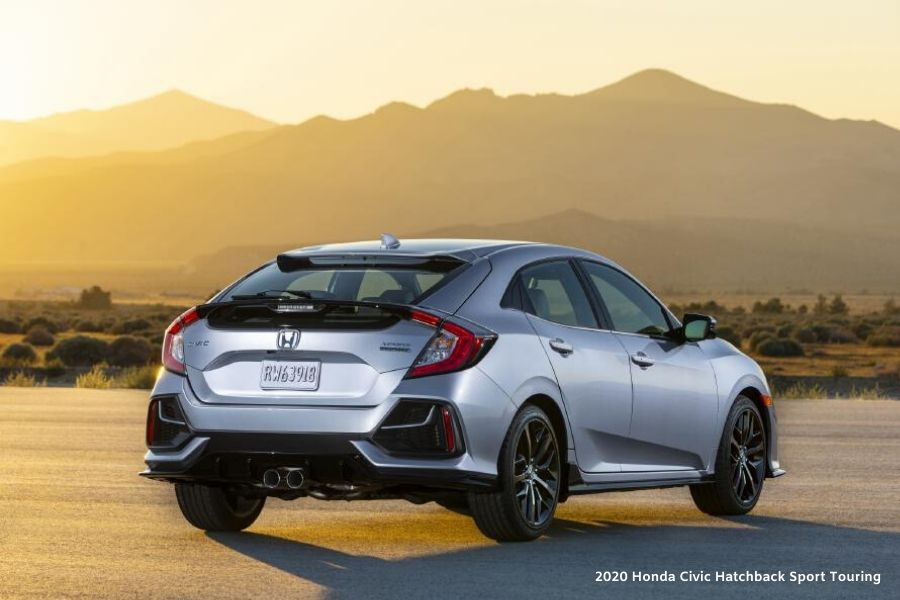 Silver 2020 Honda Civic Hatchback Sport Touring from back exterior view in front of mountains