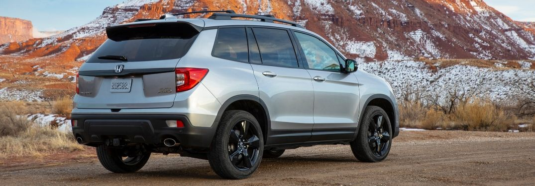 2019 Honda Passport in front of outcrop from exterior rear passenger side
