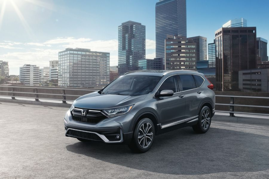 2020 Honda CR-V parked on top of parking garage in city from exterior front driver side