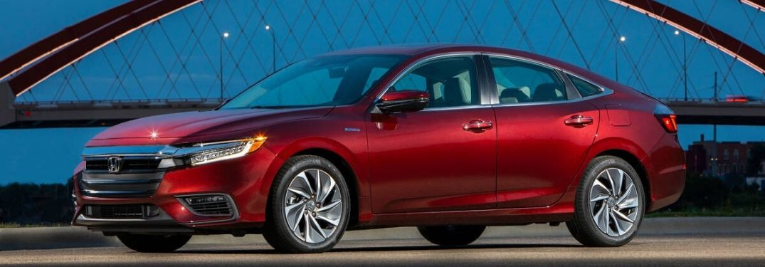Red 2020 Honda Insight from exterior passenger side