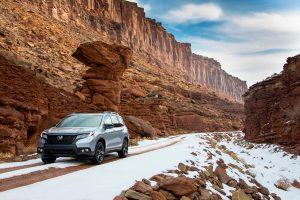 2020 Honda Passport driving between mountains