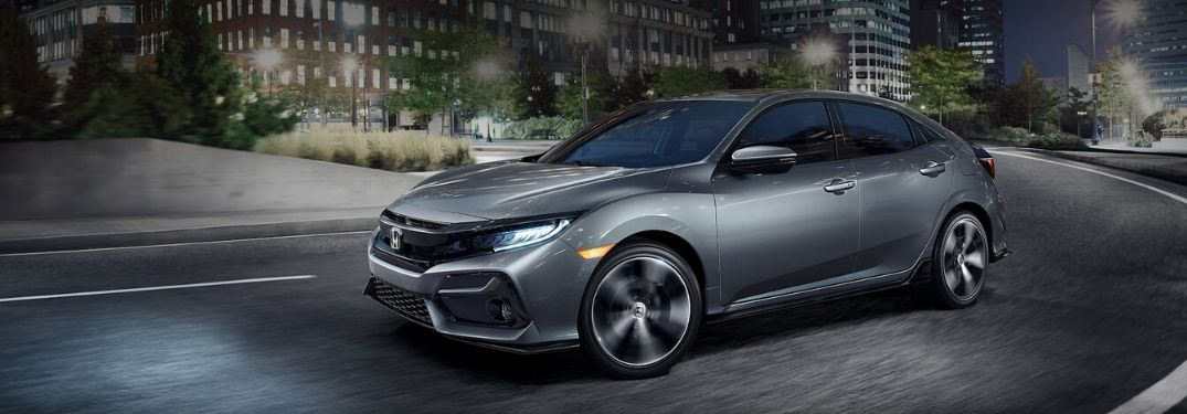 2020 Honda Civic Hatchback driving through city