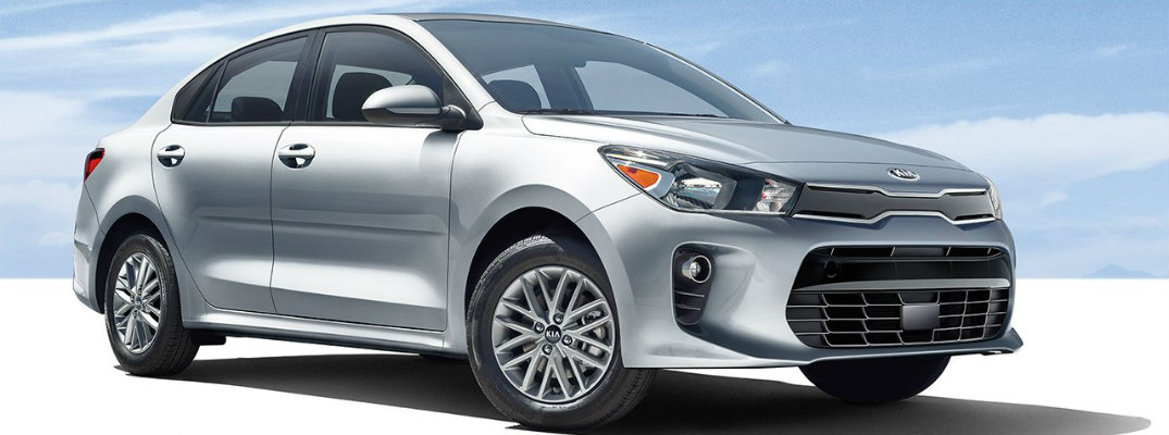 2018 Kia Rio exterior shot with blue sky parked on stark white ground