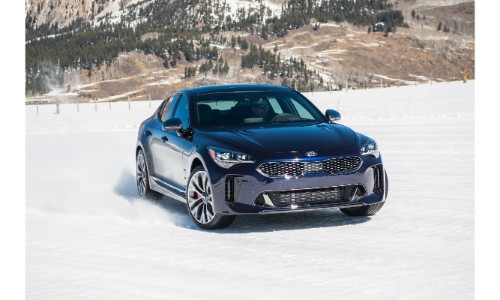 2018 Kia Stinger GT Atlantica limited edition trim level driving and kicking up snow with tires