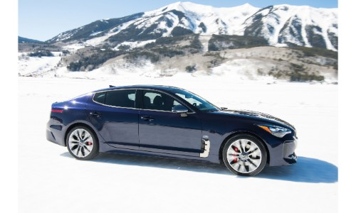 2018 Kia Stinger GT Atlantica limited edition trim level parked in the snow with snowy mountains