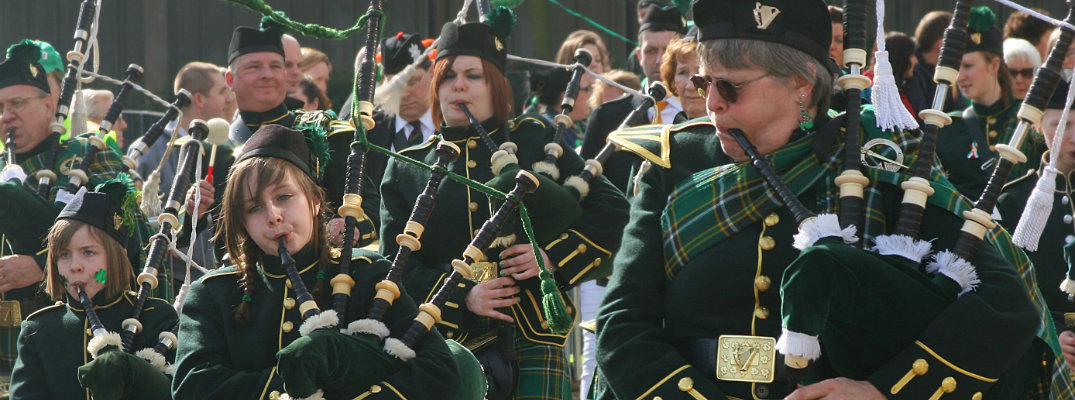 St. Patrick's Day Irishmen pipers parade march