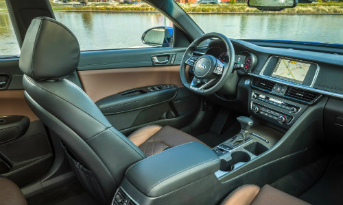 2019 Kia Optima new york international auto show interior angle shot of front seat upholstery, steering wheel, dashboard infotainment, and transmission