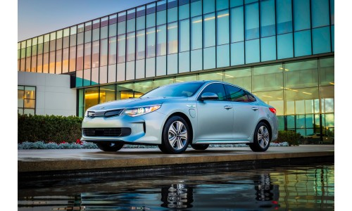 2018 Kia Optima Plug-In Hybrid gray exterior shot next to fancy pool in front of a dealership