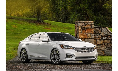 2019 Kia Cadenza white exterior shot outside a country estate