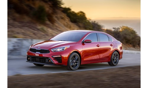 2019 Kia Forte red exterior shot around a cliff seaside