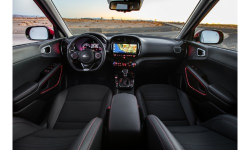 2020 Kia Soul GT Line interior shot of front seating and dashboard organization of transmission, infotainment display, driver information cluster, and steering wheel