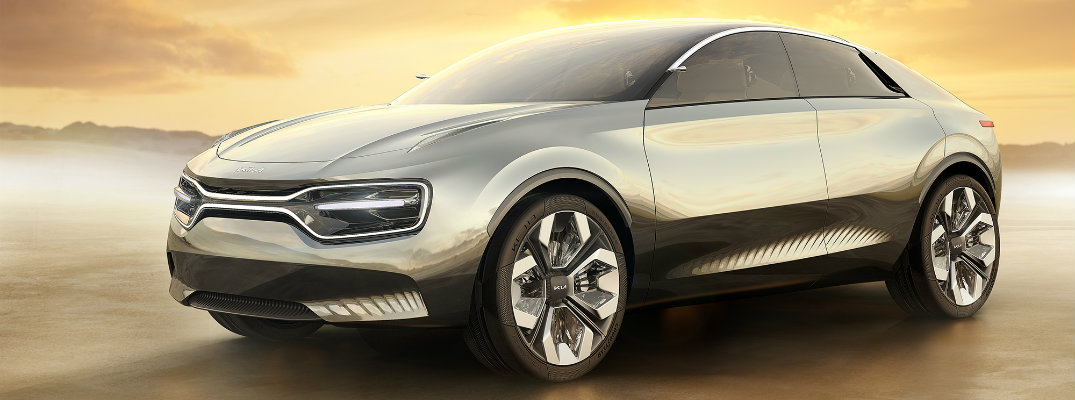 Imagine by Kia electric concept car exterior shot parked on an empty plain with a sunset behind it