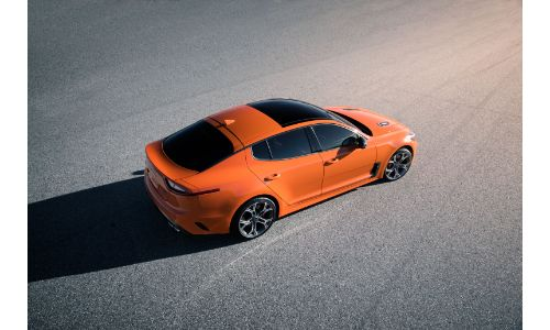 2019 Kia Stinger GTS special edition exterior overhead shot with orange paint color parked on an asphalt lot