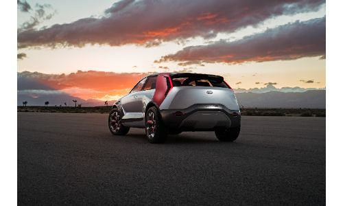 Kia HabaNiro electric concept exterior rear shot showing back bumper and trunk design as the sun sets in the background