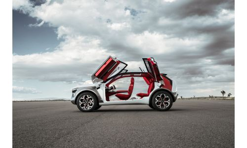 Kia HabaNiro electric concept exterior side shot as doors fold up out of the frame