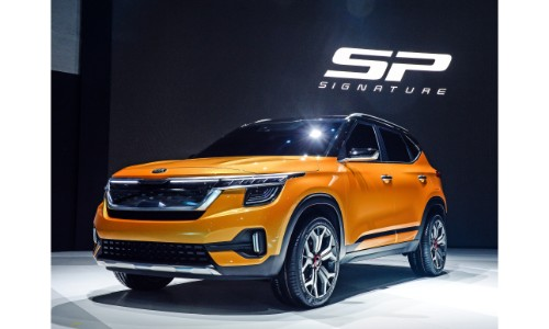 Kia Signature SP concept exterior front shot with orange paint color on stage at the 2019 Seoul Motor Show