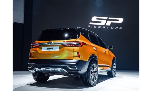 Kia Signature SP concept exterior rear shot with orange paint color on stage at the 2019 Seoul Motor Show