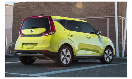 2020 Kia Soul EV exterior rear shot showing unique rear taillight wrap with yellow green paint color