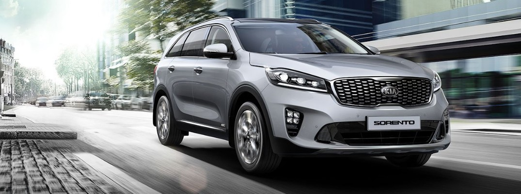Silver 2019 Kia Sorento driving on city street