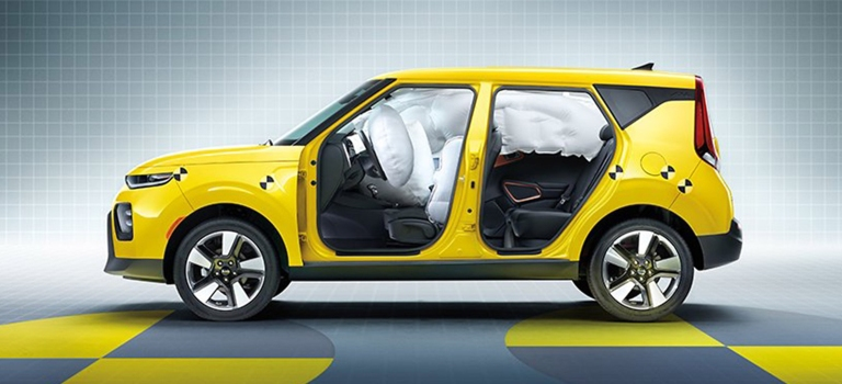 2020 Kia Soul yellow side view with airbags