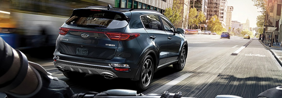 2020 Kia Sportage blue back view from a bicycle