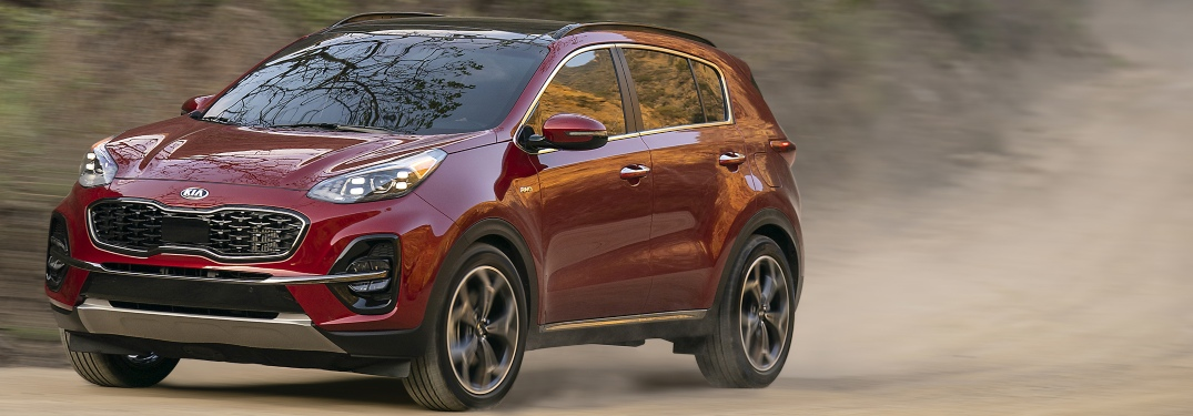 2020 Kia Sportage red side view in dirt