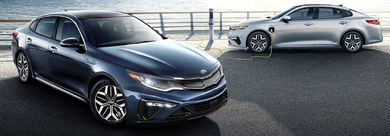 2020 kia optima parked next to another model