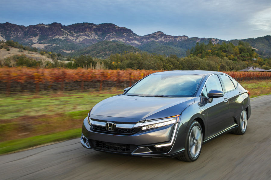 2018 honda clarity plug-in hybrid electric vehicle driving in front of mountains