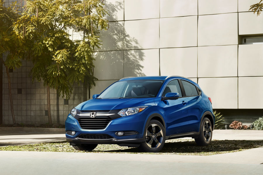 blue 2018 honda hr-v parked in front of building in city