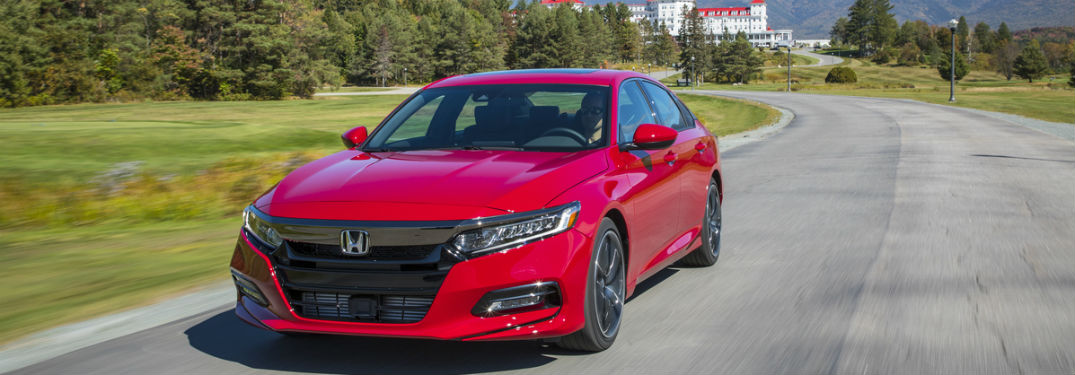 Red Honda Accord 2.0T sport driving on highway