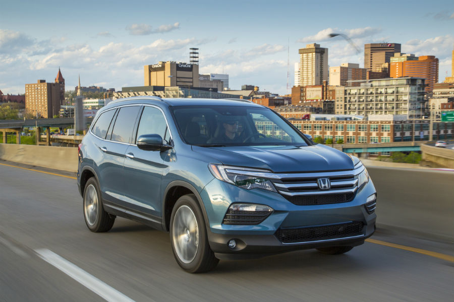 2018 Honda pilot elite driving in front of skyline