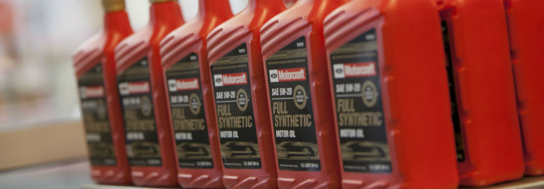 ... Row Of Synthetic Oil Containers